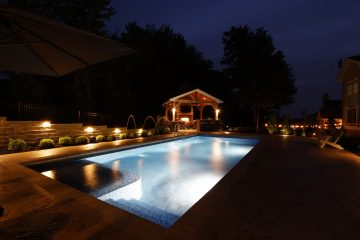 Illuminated pool, pool deck and outdoor living area